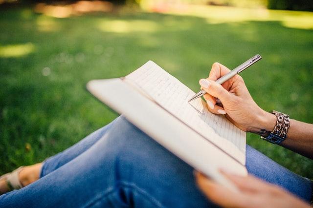 writer sitting in grass